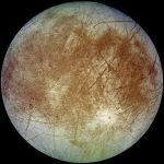 Europa, Jupiter's fourth largest moon, has an ocean of liquid water underneath its surface of ice. (Photo: NASA)