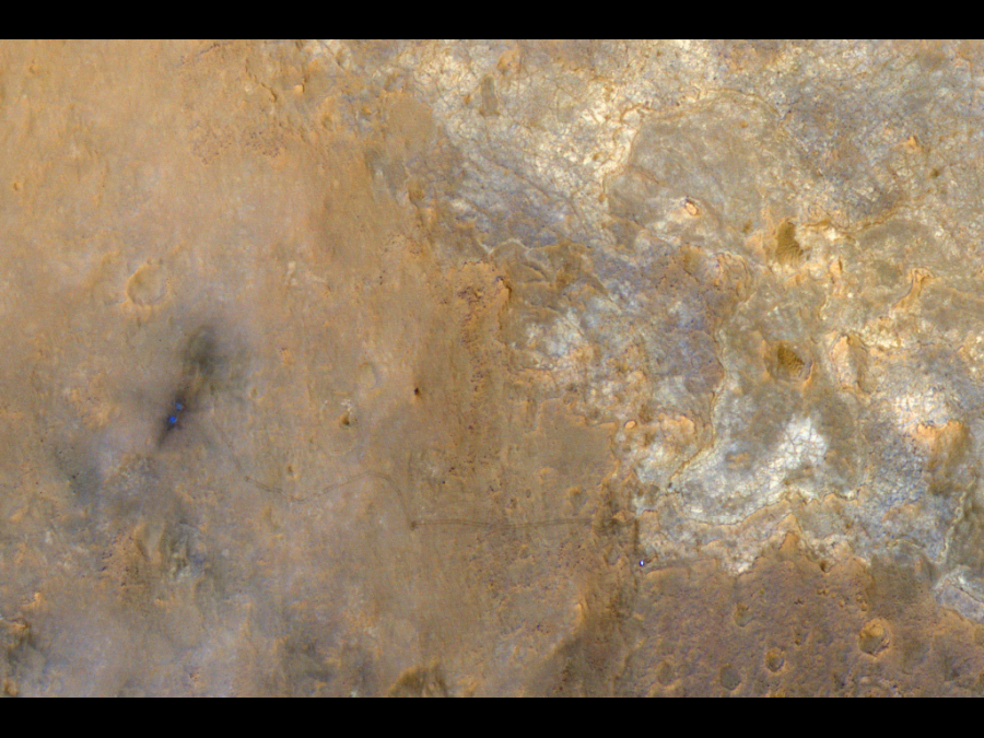 The Mars Reconnaissance Orbiter images the rover Curiosity and its tracks.